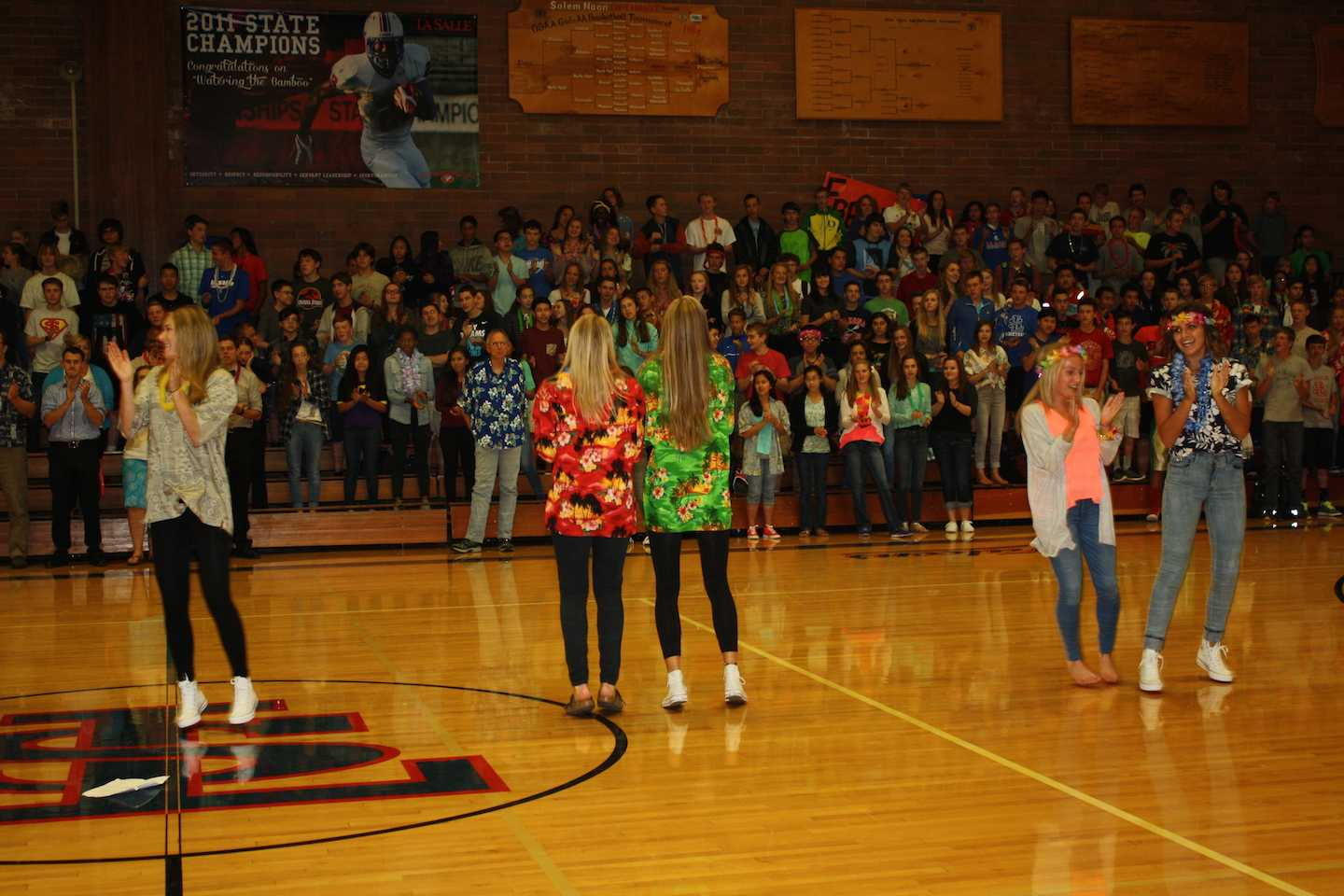 Members of the Spirit Club get the students pumped for the football game during Welcome Week.