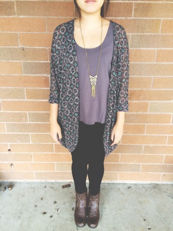 Junior Shannon Tran is wearing a bright tanktop, with a floral kimono, a necklace, black pants and combat boots. This outfit is simple and has a great spring feel to it.