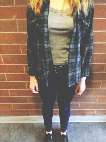 Freshman Allison Stewart wears jeans, a graphic tee with a flannel on top. The flannel completes this look that Ally is going for. This is just one of the many ways to wear a flannel.