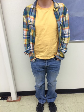 Junior Brock Nichols wears a bright flannel with a yellow shirt and light jeans. All of these pieces come together to form a perfect spring look.