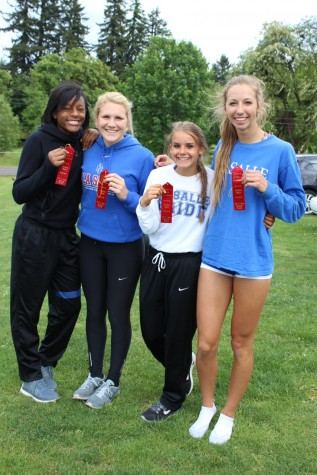Track and Field Athletes Break Records, Depart for State