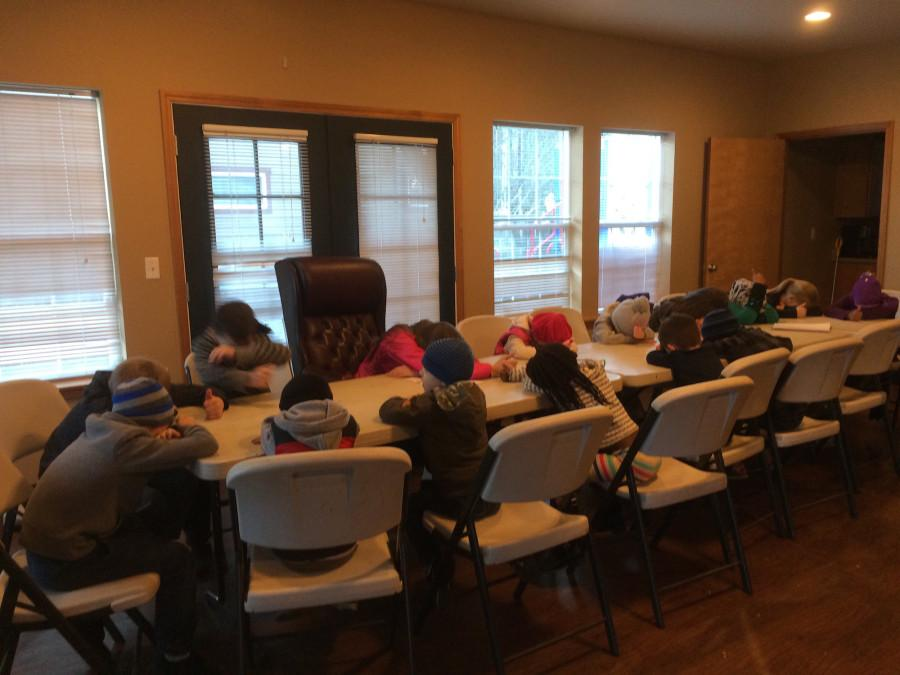 Volunteers play 'Heads Up 7 Up' at Northwest Housing Alternatives