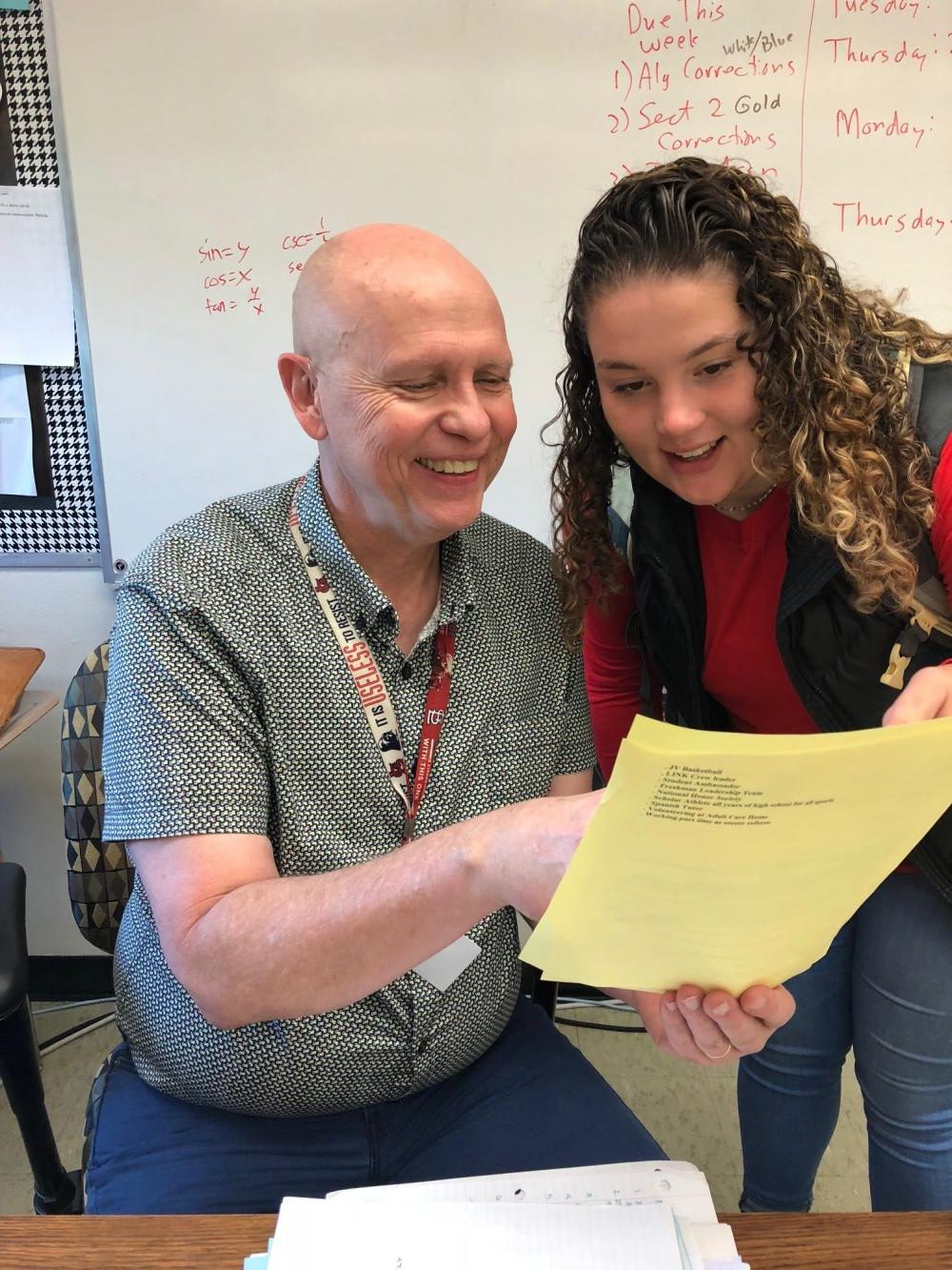 Mr. Swanson's favorite part of his job is working with students, pictured here with senior Megan Lyver.