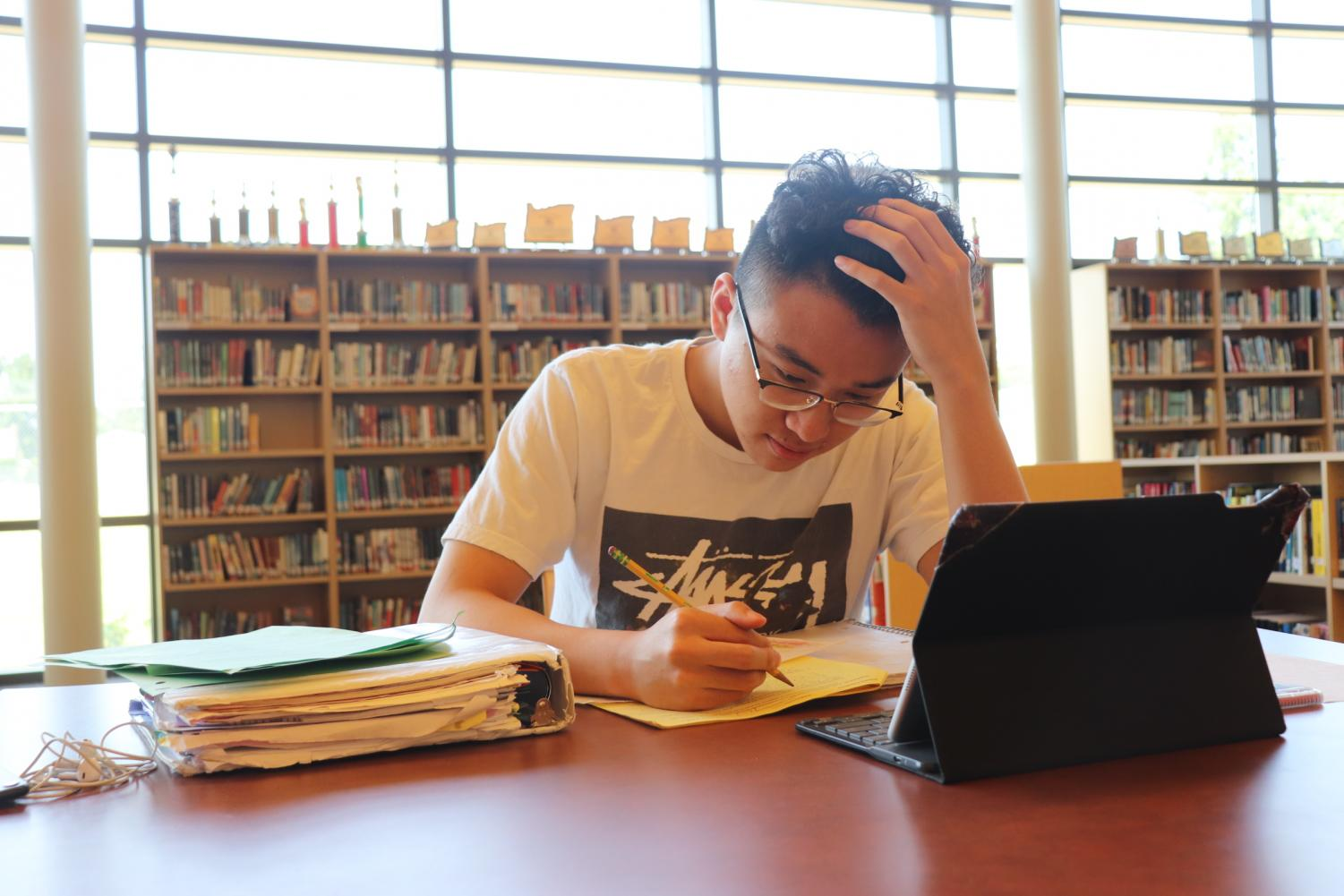 Senior Ben Luu hard at work studying in the library. Although schoolwork is important, so is taking a break and finding time for yourself.