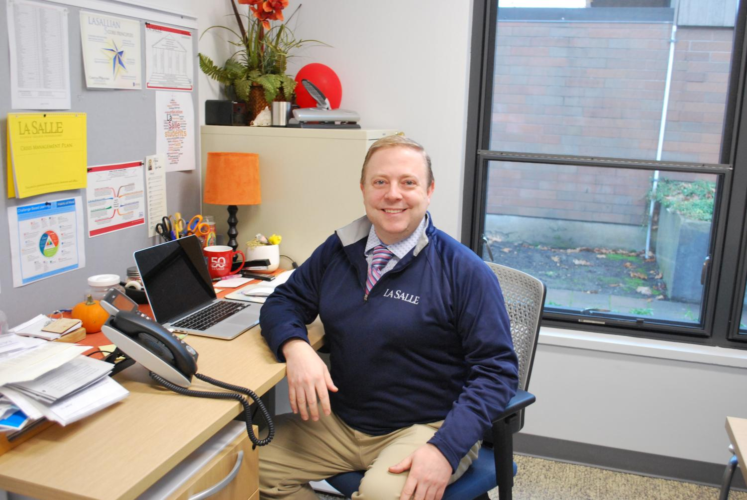 Taking on the role of both principal and president this year, Mr. Kuffner is seen here in his office.