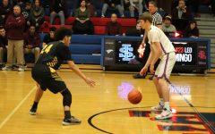 Winter Sports in Action: #11 Varsity Boys Basketball Team Defeats #19 Milwaukie 65-50