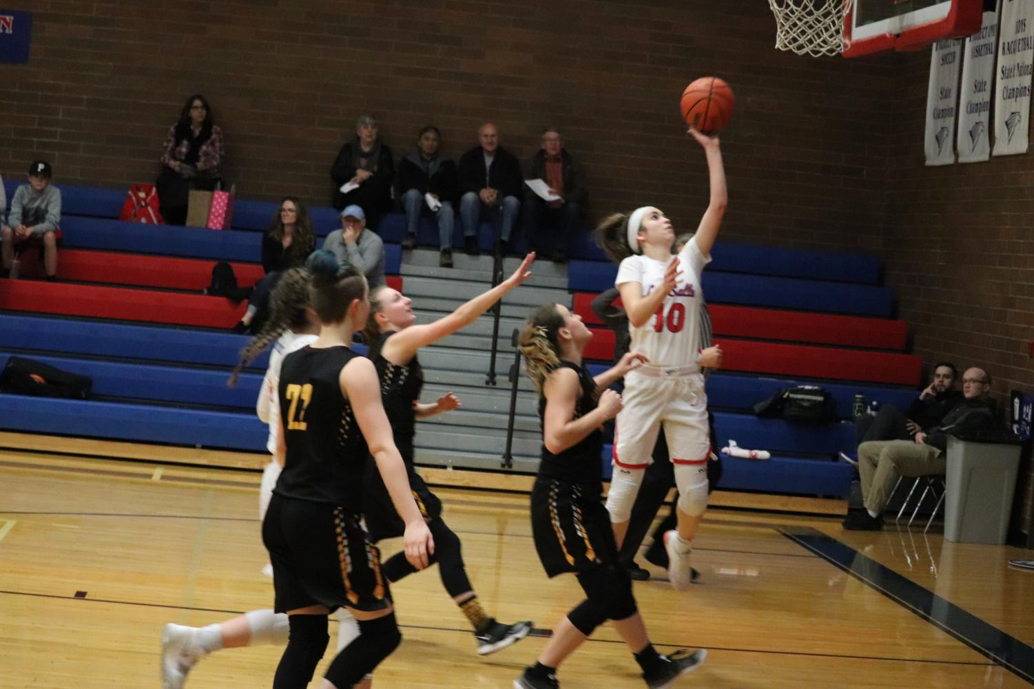 Sophomore Mandy Sisul goes in for layup.