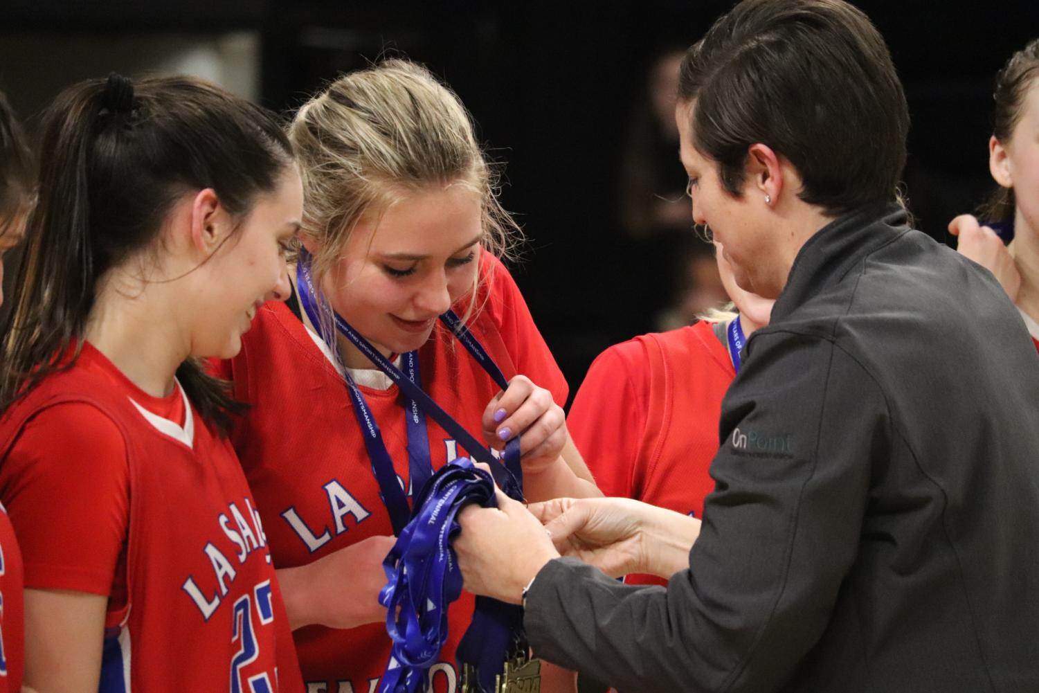 Wedin+gets+her+first+place+medal+on+top+of+her+First+Team+All-Tournament+medal+that+she+was+awarded+just+moments+before+alongside+Miura.