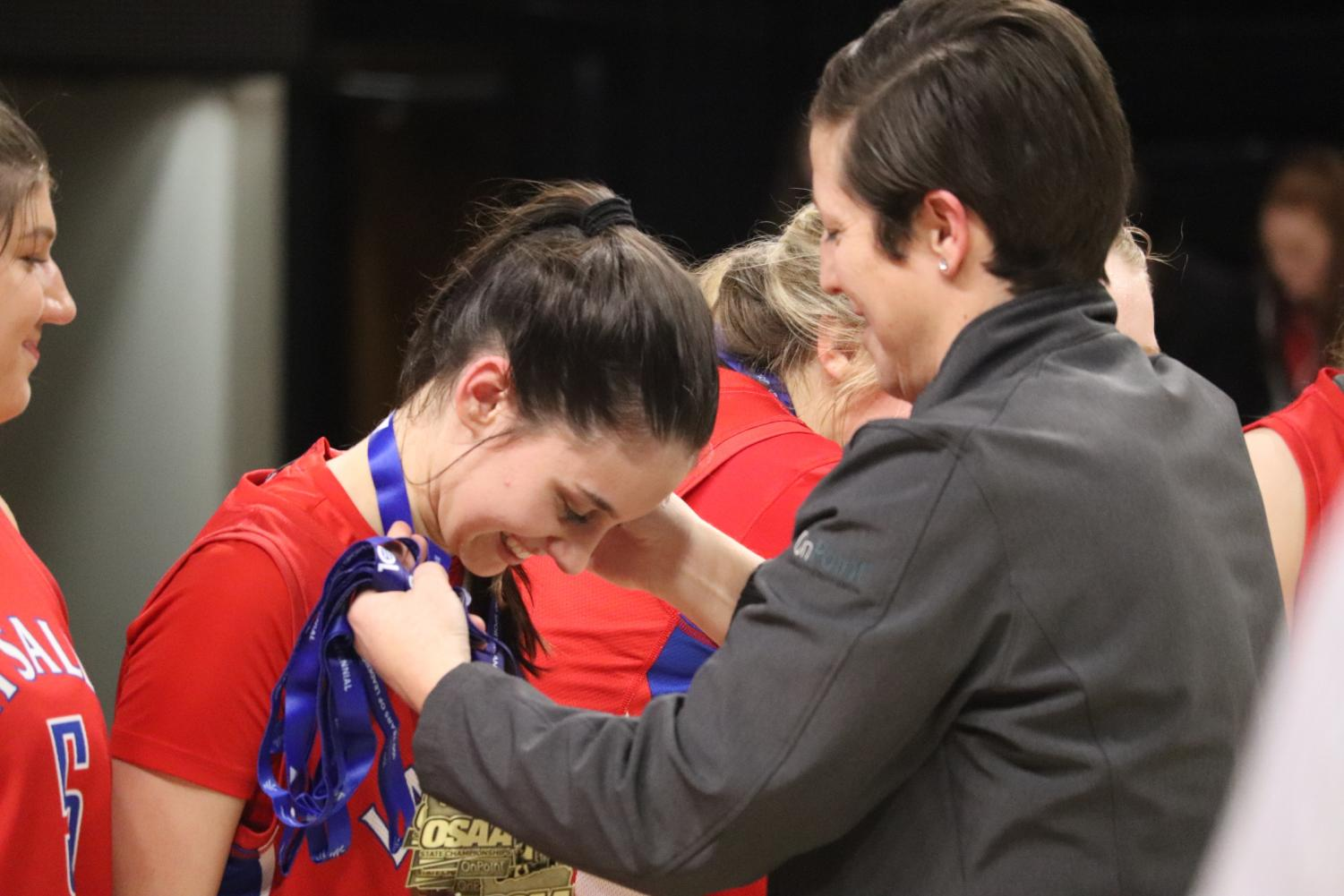 Skoro%2C+only+a+freshman%2C+receives+her+state+championship+medal.