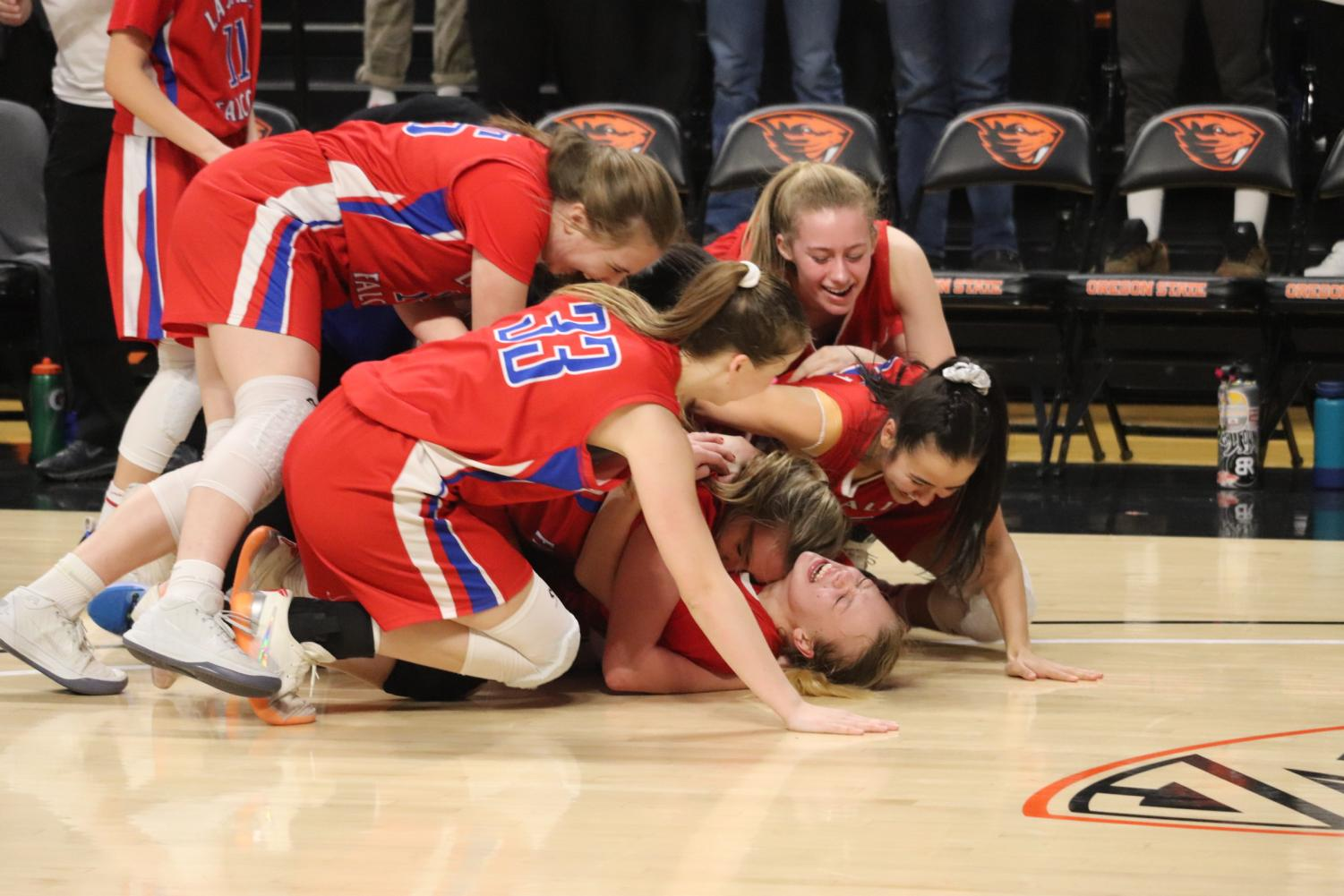 The+girls+dog+pile+on+Niebergall%2C+celebrating+the+victory.