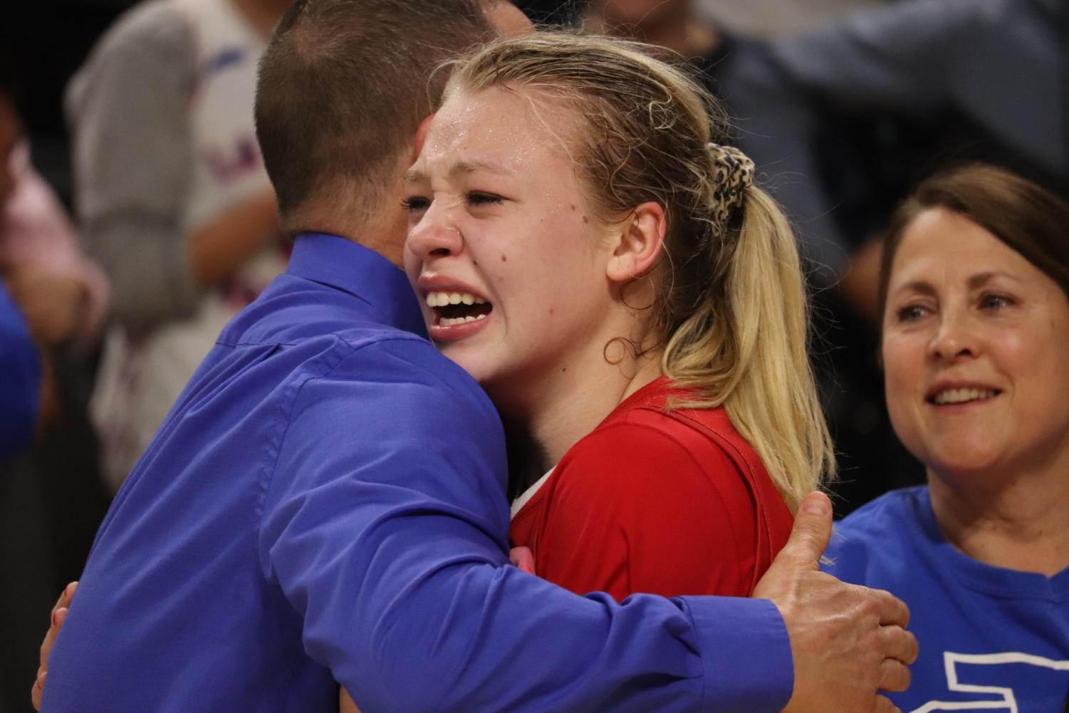 Jim+Simms%2C+one+of+the+assistant+coaches%2C+embraces+Niebergall+as+tears+run+down+her+face.