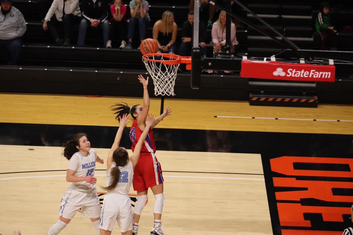 Miura+lands+a+twisted+layup+after+finessing+her+way+through+several+Springfield+defenders.