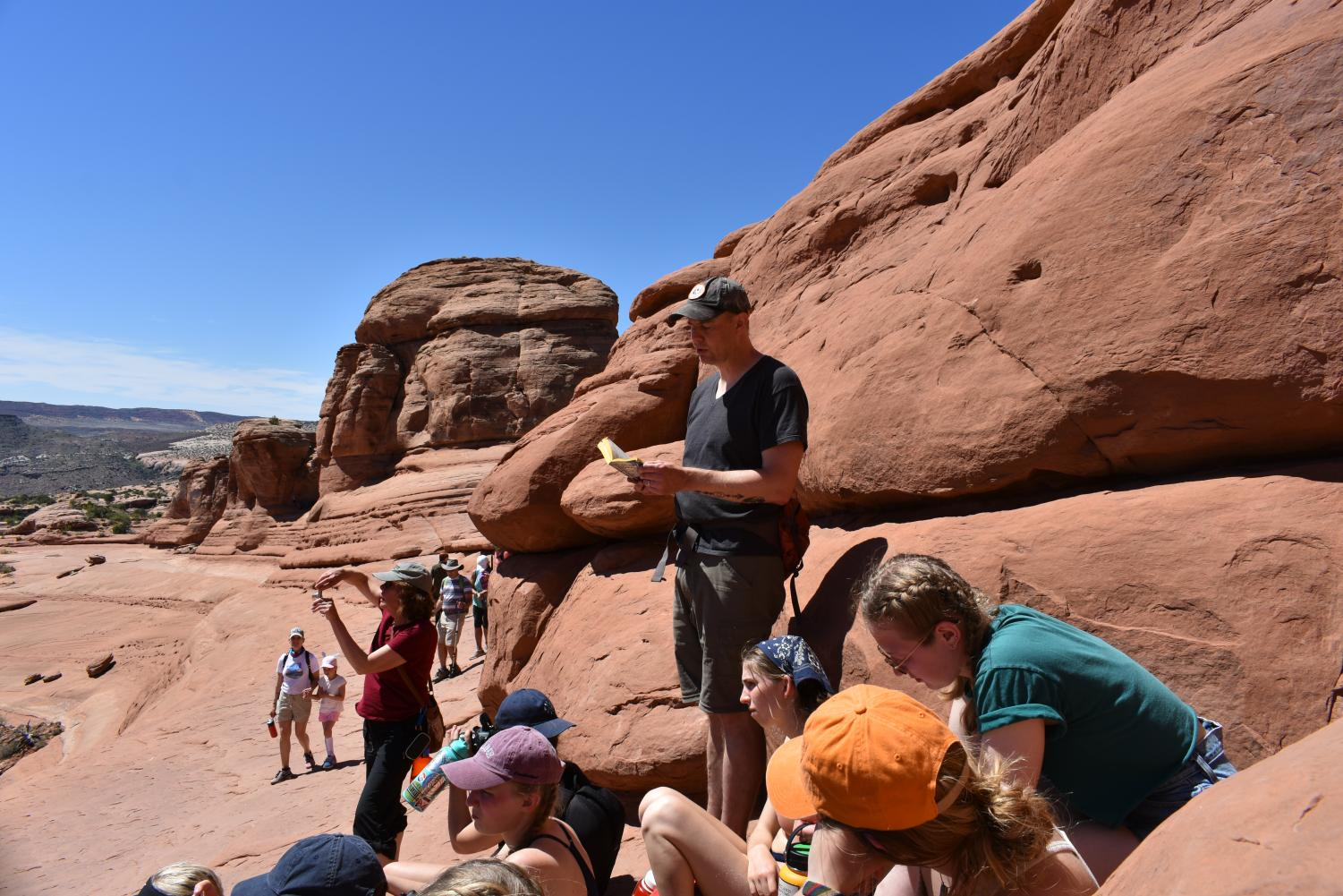 Students+sat+in+silence+as+Mr.+Dreisbach+read+aloud+a+passage+about+the+beauty+of+Arches+National+Park+and+the+Colorado+Plateau.+