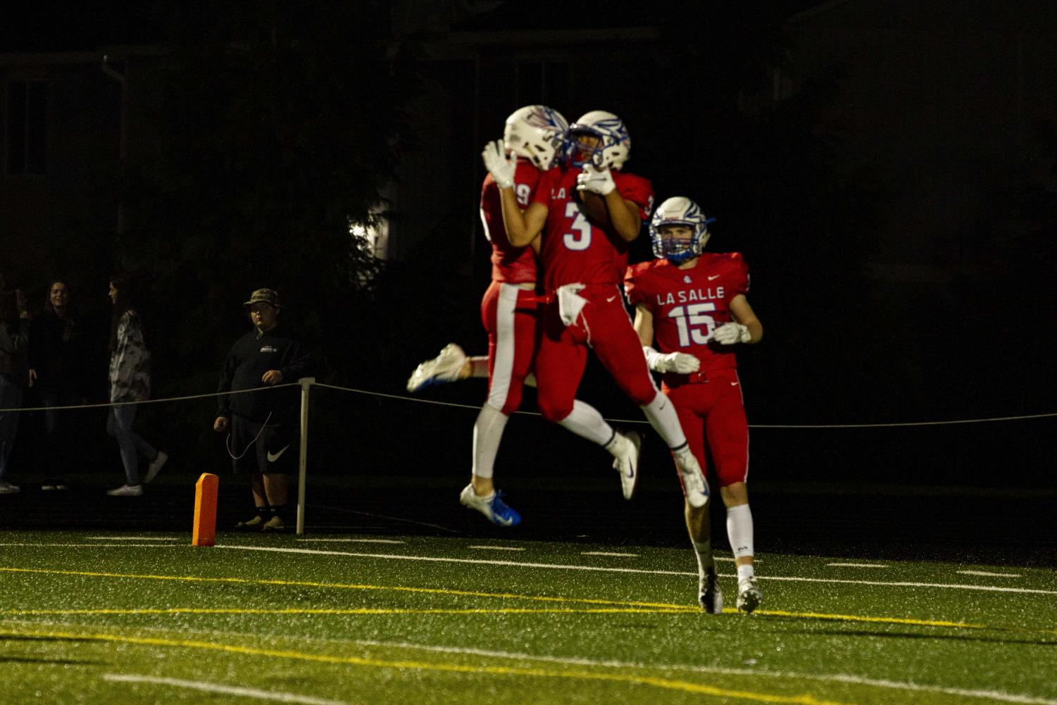 Junior+James+Menor+%283%29+scores+a+touchdown+and+celebrates+with+teammates.