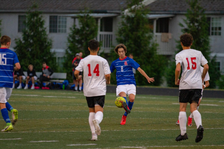 Senior+Sky+Charley-Bolyard+kicks+the+ball.