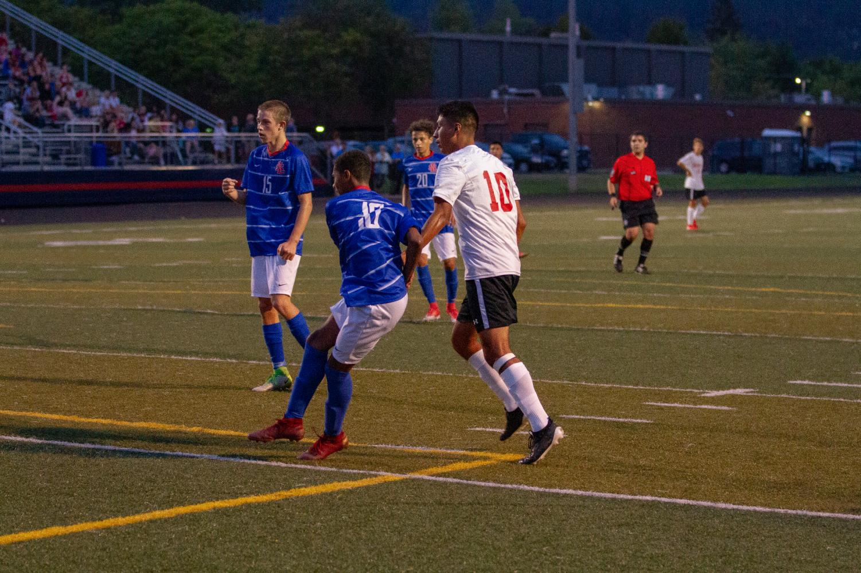 Sophomore+Mizael+Harris+fends+off+a+defender+after+taking+a+shot.