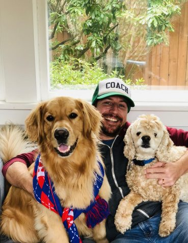 Mr. Seth Altshuler poses with his dogs, Larry and Doug.
