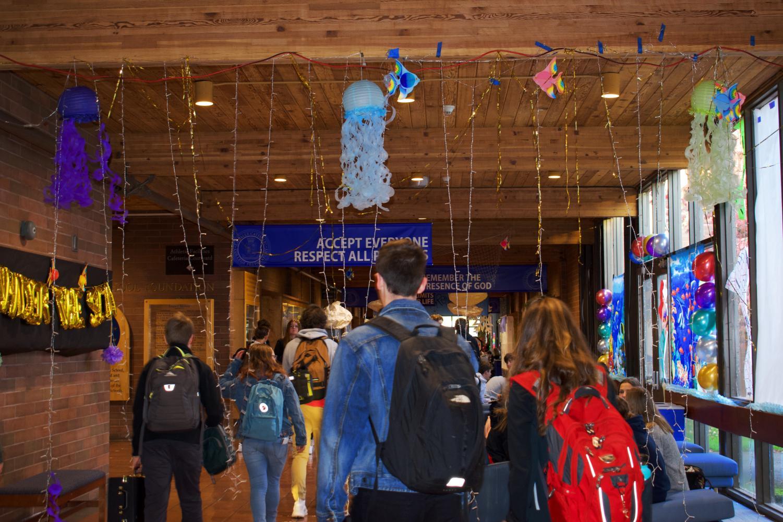 Students+walk+through+the+Disney-themed+main+hallway+on+Monday+morning.