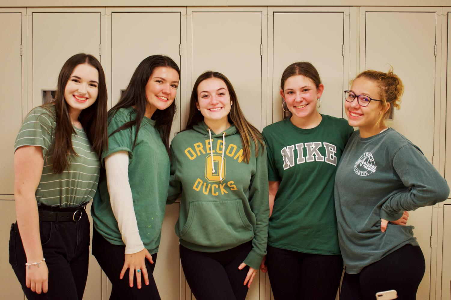 Seniors+show+off+their+green+shirts+to+represent+the+class+of+2020+on+class+colors+day.