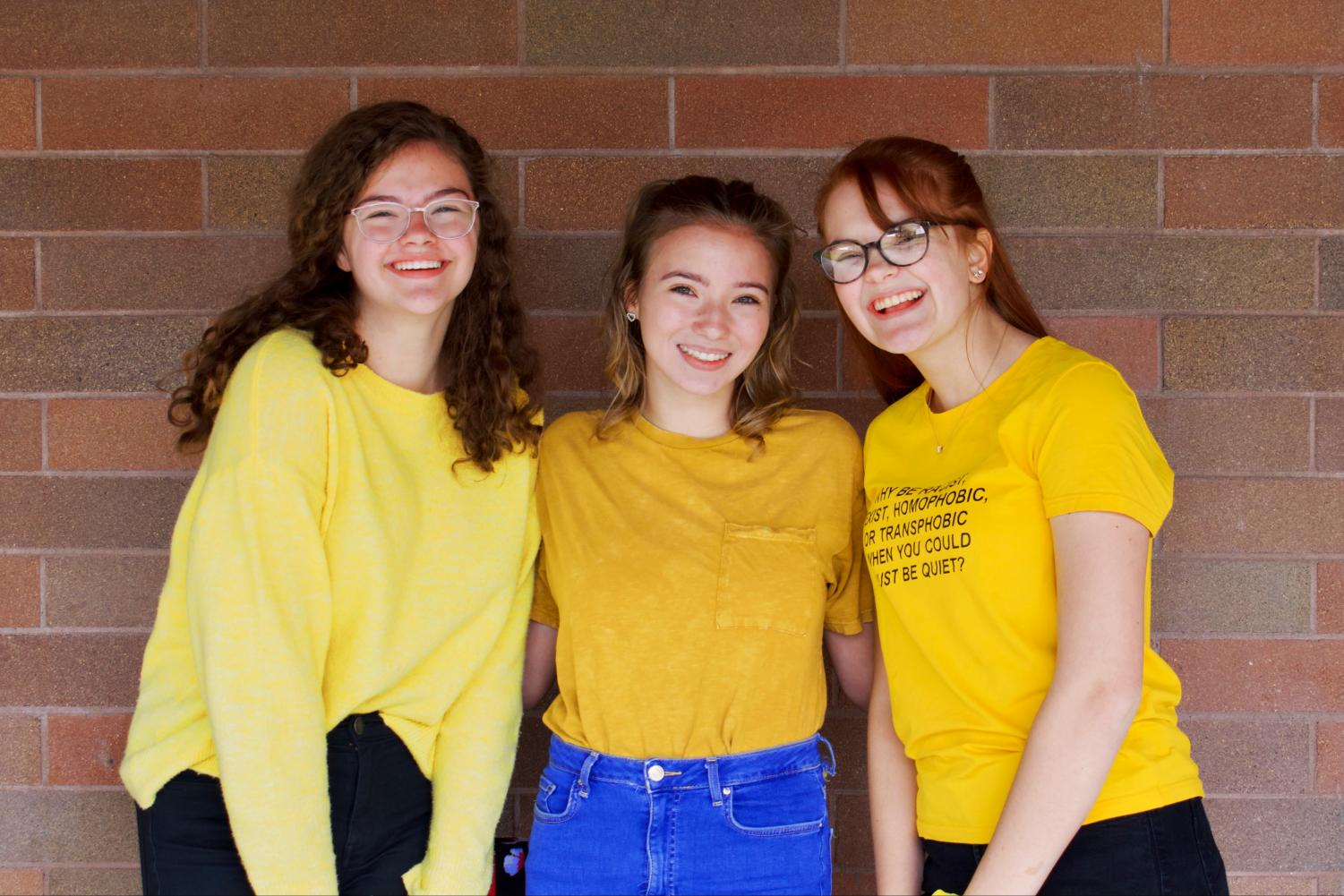 Freshmen+Isabella+Simonutti%2C+Lilly+Tiller%2C+and+Kamryn+Houghton+wear+yellow+to+represent+the+class+of+2023+on+class+colors+day.