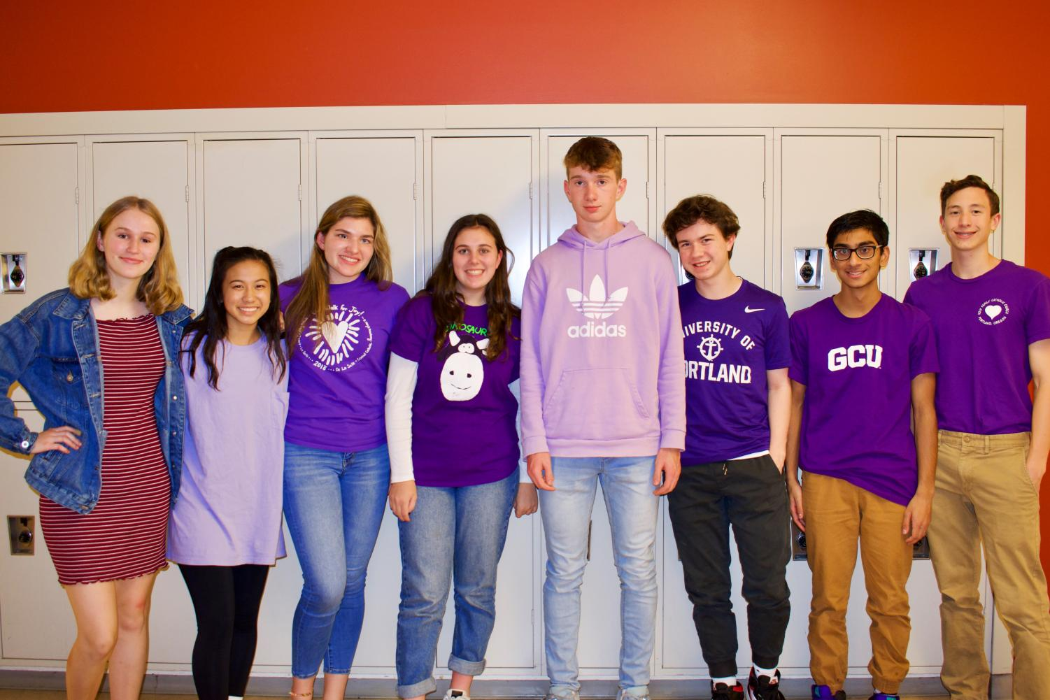 Sophomores+show+off+their+purple+shirts+representing+the+class+of+2022+on+class+colors+day.