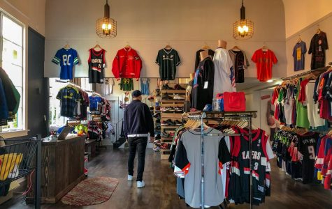 Junior Robby Collman browses the shoe and clothing selection at GOAT, a new sports and street style shop in Sellwood.