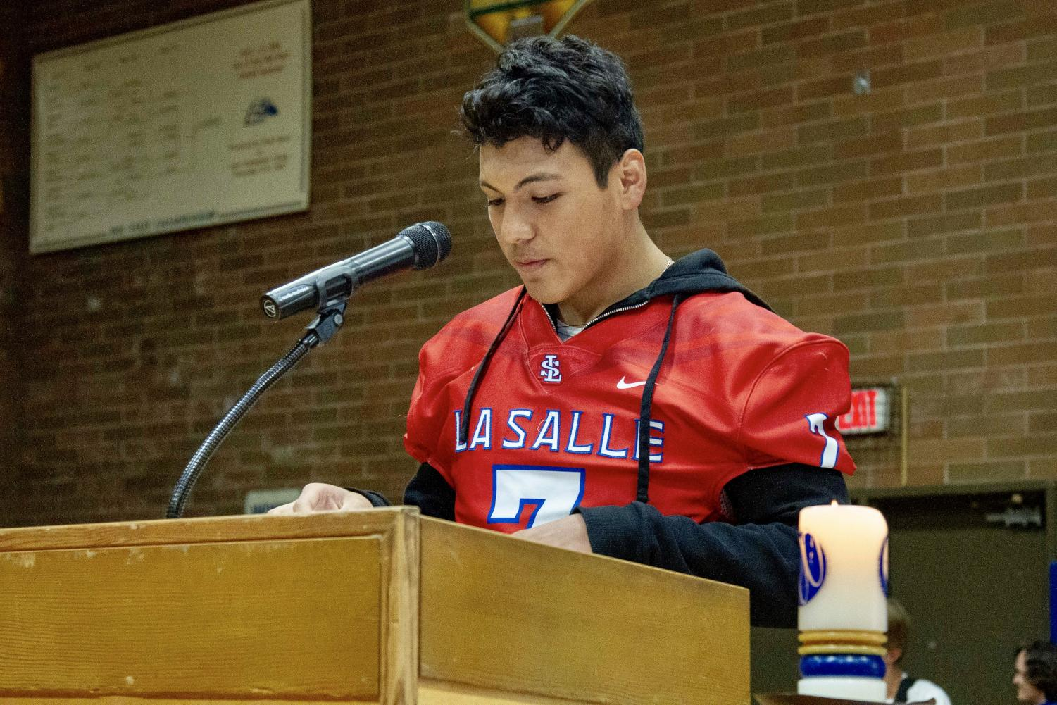 Senior+Brandon+Lopez+represents+the+football+team+as+he+reads+the+responsorial+psalm+during+mass.