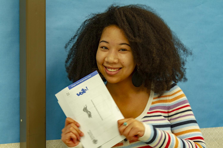 Senior Amira Tripp Folsom shows the form to register to vote.