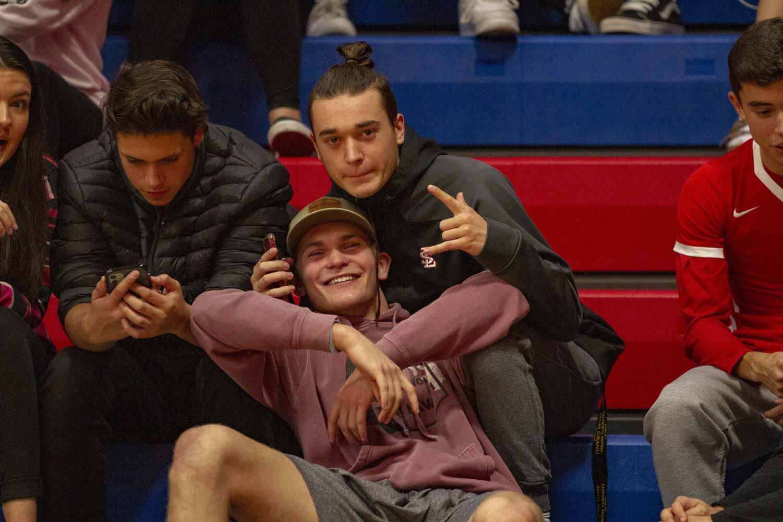 Seniors+Dominic+Serio+and+Ryan+Bjorvik+watch+the+game+from+the+bleachers.