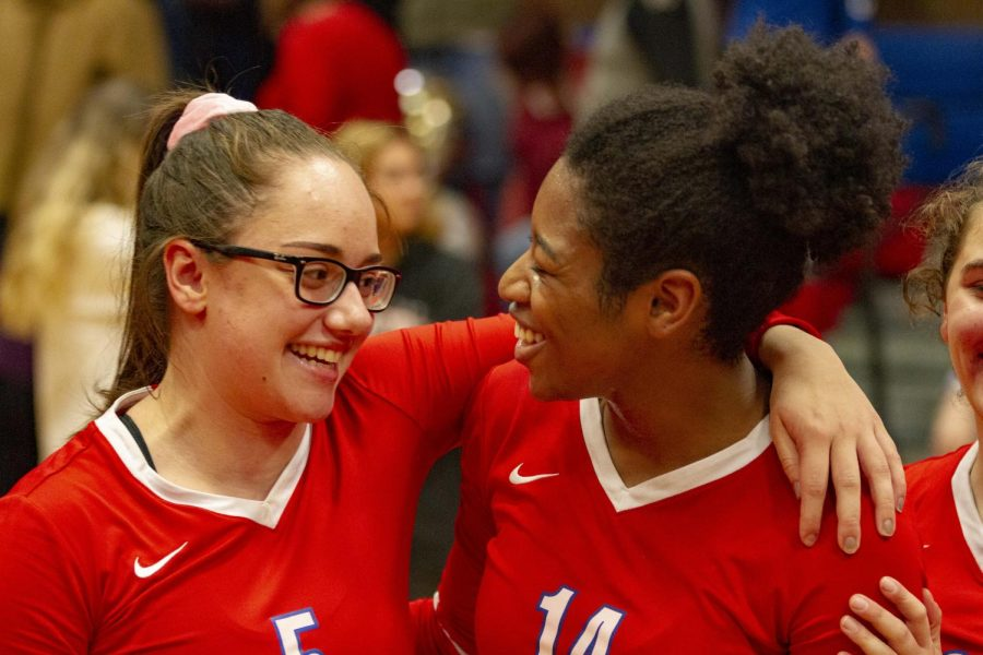Seniors Ashley Smith and Mary Gach celebrate their last home game victory together.
