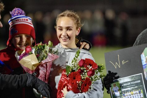 Nebels receives flowers from her family and teammates.