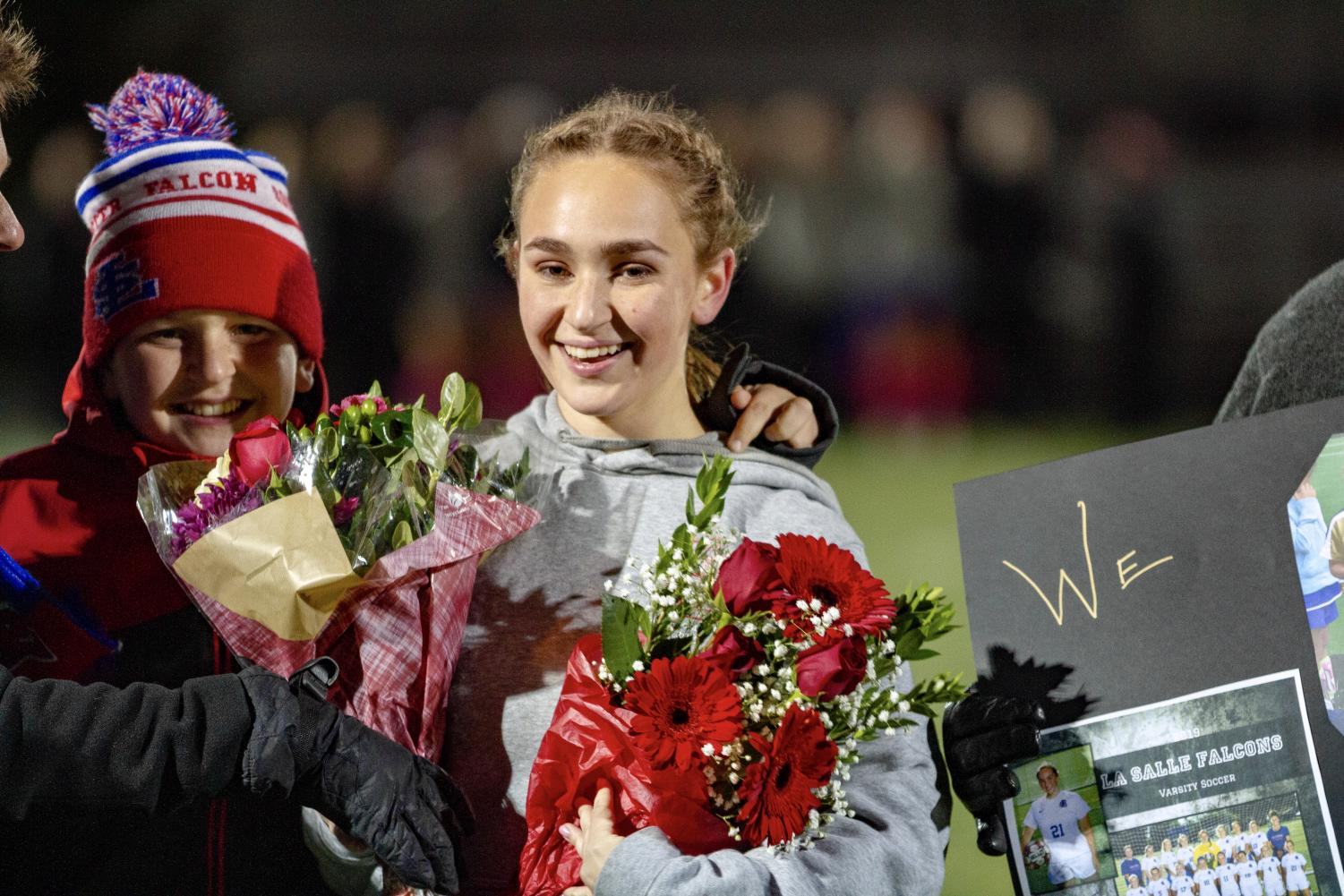 Nebels+receives+flowers+from+her+family+and+teammates.