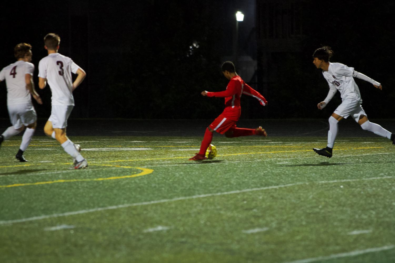 Sophomore+Mizael+Harris+%2810%29+kicking+the+ball+towards+the+goal.