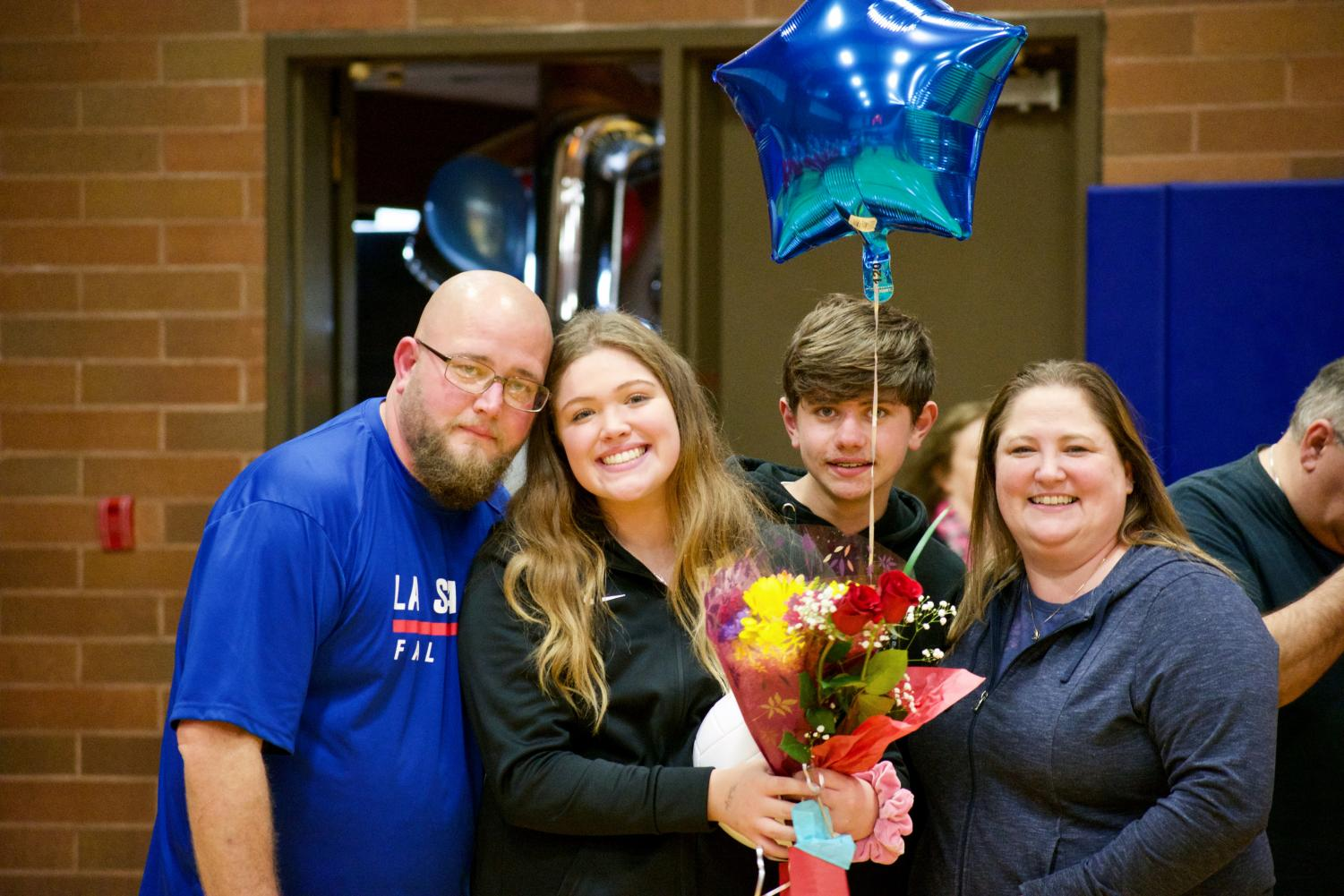 Lauren+Patrick+is+recognized+at+senior+night+and+accompanied+by+her+family.