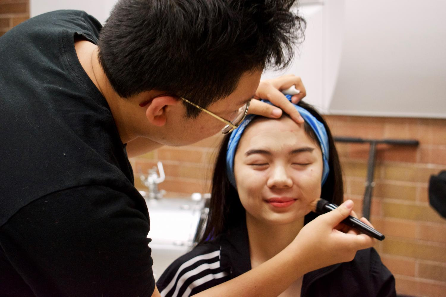 Senior+Alvina+Hsiao%2C+playing+Gay%2C+gets+her+makeup+done+by+junior+Elvan+Ngo.