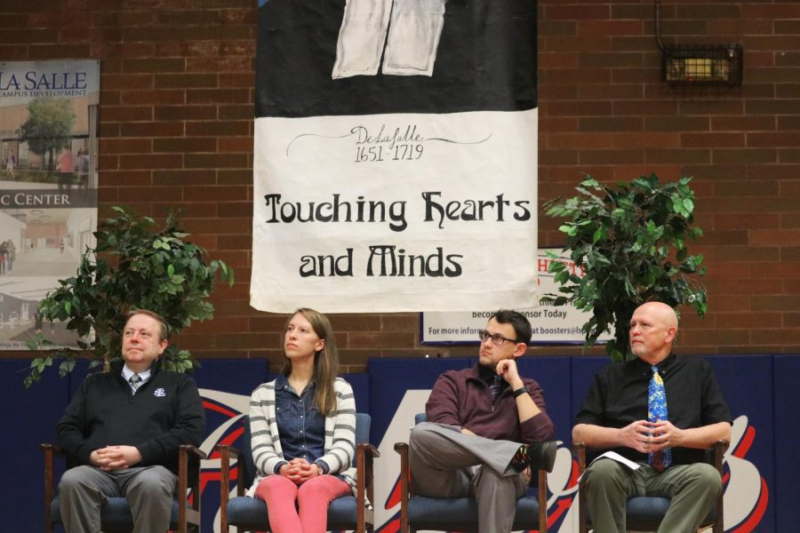 Faculty from La Salle listen to the many student speakers at the Heroic Vow assembly.