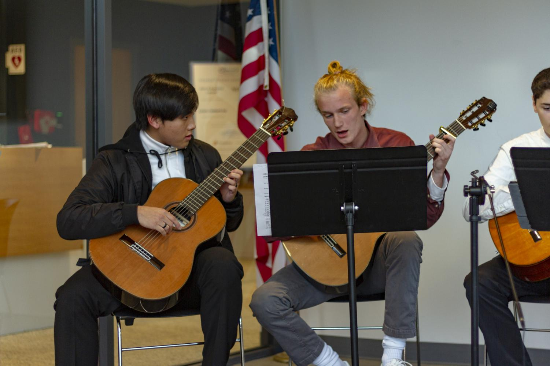 Guitar+students+Tony+Nguyen+and+Quinten+Struyk-Bonn+play+in+the+main+entrance.