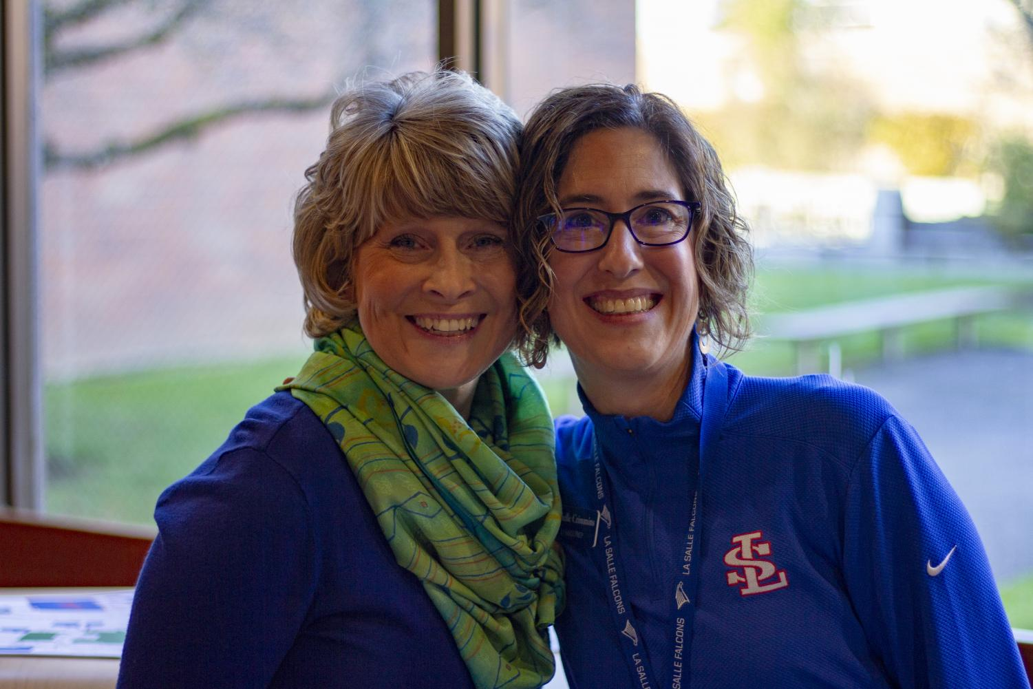 Director+of+Giving+and+Donor+Relations+Ms.+Julie+Dowhaniuk+and+Director+of+Alumni+Giving+Ms.+Michelle+Crimmins+pose+together+in+the+main+hallway.