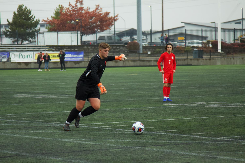 Goalie+senior+Quintin+Castner+kicks+the+ball+into+play.