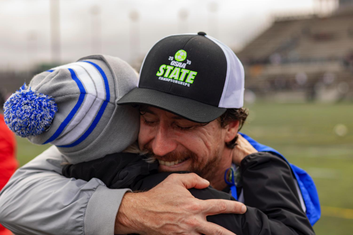 Coach+Altshuler+hugs+his+father+after+winning+the+state+championship.