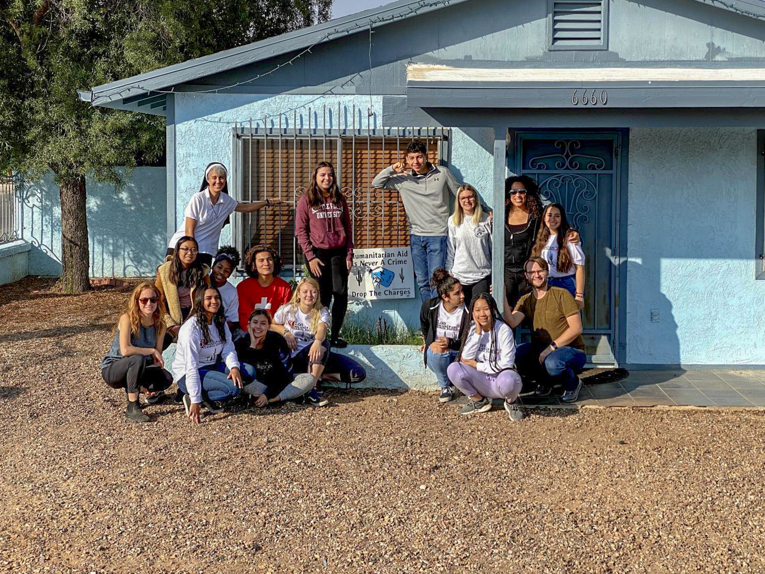 The immersion attendees gather outside of their home for the week.