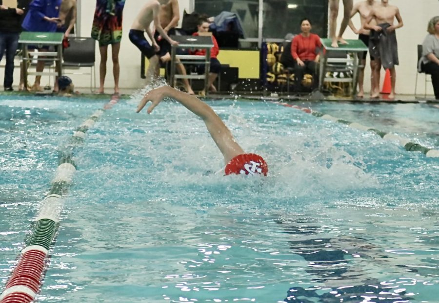 Jensen swims in the winter to build up his strength before baseball season begins in the spring.