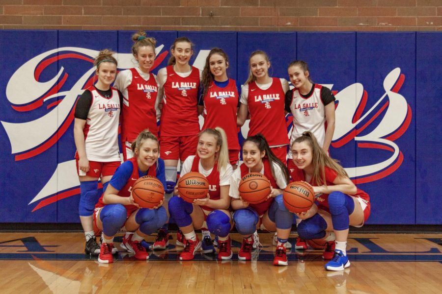 The varsity girls basketball team is made up of 11 players. Junior Addi Wedin is not pictured.