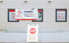 An urgent care center in Oregon City displays signs warning visitors to take necessary social distancing precautions.