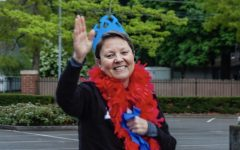 Ms. Powell waves to students at a recent
