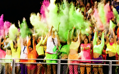 Students of La Salle Prep throw colored powder into the air at the end of halftime at the first home football game of the season. La Salle lost the game against St. Bernard's Academy, a school from California, with a final score of 41-43.