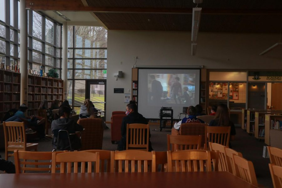 Students gathered in the library to watch Home Alone.