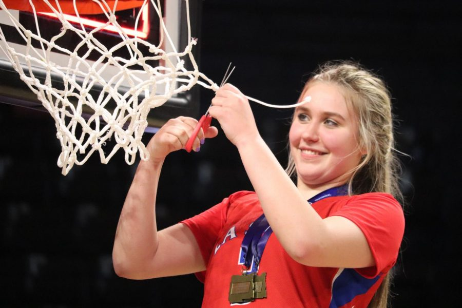 After winning the state championship with her team in 2019, Wedin smiled as she cut off a piece of the net from the championship game.