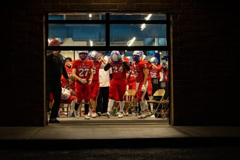 The team emerged from the athletic center after a halftime discussion.