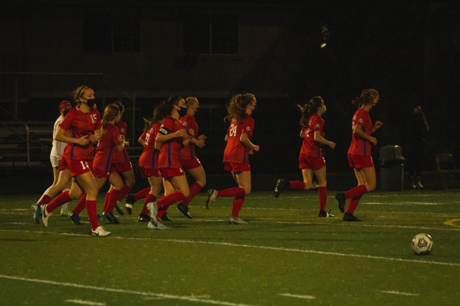 The varsity girls soccer team won their game against Oregon City High School with a final score of 4-0.